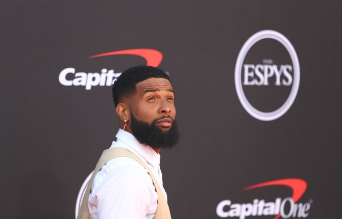 Odell Beckham Jr shaved his blonde hair f and seen wearing earring only in his right ear