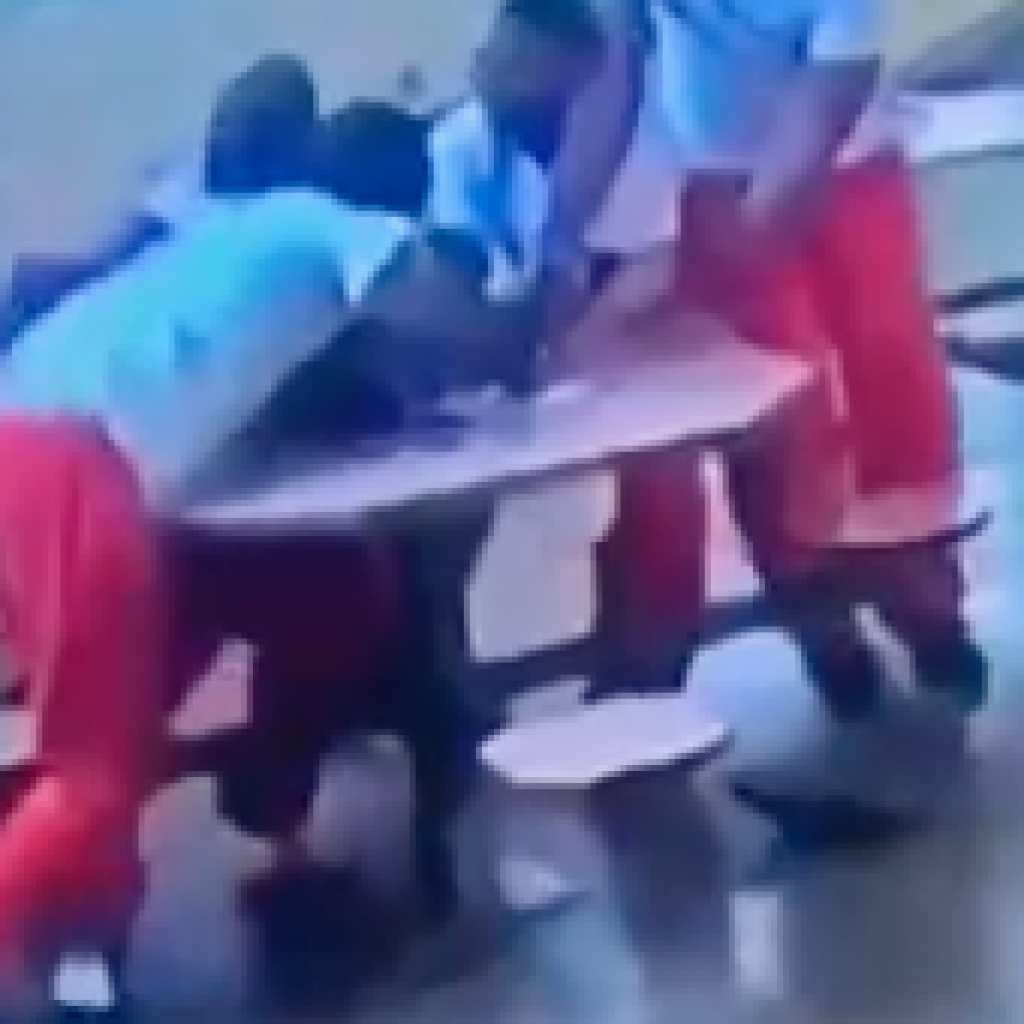 Graphic video of White Corrections officer handcuffing 4 prisoners to table so White supremacist prisoner can stab them